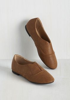 Five Star Perforating Flat in Cognac. Street style critics will have only positive reviews of these perforated flats! #brown #modcloth