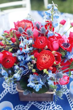In love with this flower arrangement: http://www.stylemepretty.com/living/2014/05/26/nautical-baby-shower/ | Photography: Melody Melikian - http://www.melodymelikianphotoblog.com/