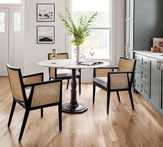 Inspired by those found in Parisian cafés, our Rae Round Marble Pedestal Dining Table features a decorative metal base and polished marble top. It's ideal for a cozy meal in a breakfast nook or for creating a stylish dining spot Marble Top Dining Table, Marble End Tables, Round Pedestal Dining Table, Black Round Dining Table, Wood Pedestal, Retro Dining Chairs, Dining Table Chairs, Dining Furniture, Dining Rooms