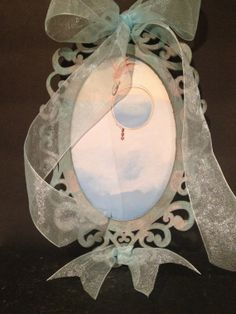 Soft blues and pinks in this filagree frame and by Bedotted, $12.50