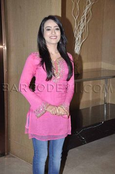 Beautiful pink kurti is designed with gold sequence work