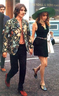 Iconic Mavericks: George and Pattie in Carnaby Street styles with George's Charming Contrasts: Mod Print Jacket, Essence shirt, and unexpected shoes. Pattie wears a 1st Base mini-dress, Ethnic Jewelry and accessories, Teal hat