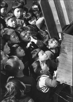 Japan Incredible Metamorphosis After World War II Children looking at a picture-card show. Tokyo, 1953.