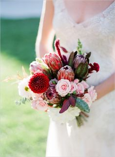 pink and red wedding bouquet #pinkflowers #redflowers #weddingchicks http://www.weddingchicks.com/2013/12/20/red-and-navy-wedding-ideas/
