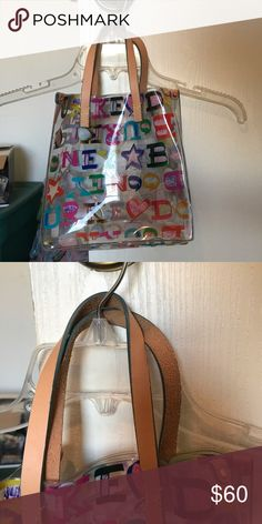 Dooney and Bourke Purse Clear overall with colorful lettering! Like new condition, only used once! Dooney & Bourke Bags