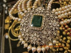 diamond pendant with emerald