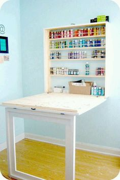 Space saving table for craft supplies! awesome :D