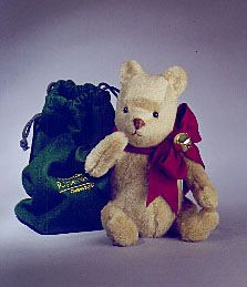 "RJW - Jingle Bell Pooh  12"", mohair plush, fully jointed, felt bow w/brass bell, custom green felt bag. Date of Release: 1998. Private Ltd. Ed. 35. Made exclusively for employees of R. JOHN WRIGHT DOLLS for Christmas 1998. Includes hand-signed certificate of authenticity."
