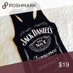 Jack Daniels graphic tank Jack Daniels graphic tank. Looks hot with ripped denim shorts or jeans. Tag says medium but fits like XS. No trades. Reasonable offers considered. Tops Tank Tops