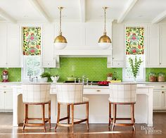 In a white kitchen, a brightly colored backsplash will pack a significant punch. Adding other colorful accents helps bold tiles mesh with the kitchen's designs. Here, charming floral shades on the windows do the trick./