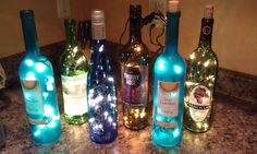 Wine bottle lights! Just drilled small holes in the back of the bottles with a diamond bit, thanks to my brother-in-law and then put a string of 20 white Christmas lights inside. ($1.99 at Hobby Lobby!)