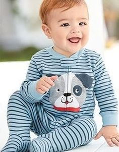 Shop sleep and play pajamas - now a comfier and looser fit, designed especially for babies, sizes new born to nine months.