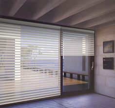 SIROCCO SHEERS A privacy fabric strip is woven in between two layers of sheer fabric to combine the light control of a Venetian blind with the simple operation of a roller blind.