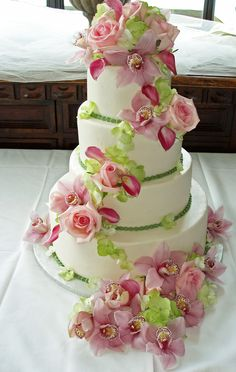 Wedding cake with Pink Roses, Pink Miniature Calla Lilies, Cymbidium Orchids and Green Hydrangea Blooms #BenevaFlowers