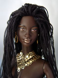 Gorgeous! I love that she has locs rather than straight, black hair! I always get really excited when I see Black Barbies who have natural hair.