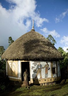 Hosanna traditional house, decorated with big frescos telling the life of the family, Ethiopia