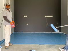 A painter with J.L. Painting of Peabody, Mass., pauses beside the partially completed epoxy floor in the garage/maker studio. The durable coating will brighten the space and make it easier to keep clean. Floor: Rust-Oleum EPOXYSHIELD (shown in Colonial Blue) #rustoleum #garagefloor Reading Loft, Maker Studios, Treads And Risers, Master Bath Shower, Quartzite Countertops, How To Install Countertops, Epoxy Floor, Decorative Trim, Back Patio