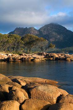 The shoreline of Coles Bay with The Hazards mountain range beyond, Freycinet National Park, Tasmania | Andrew Watson Photography