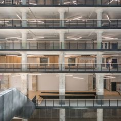 """Archimania paired wooden elements with """"gritty concrete and textured brick"""" at this higher-education facility, housed in a former industrial building"""