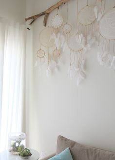 idea for guest bedroom -- just hanging doilies though, not dream catchers.