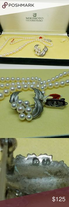 Mikimoto Pearl Silver Brooch Genuine  Mikimoto cultured Akoya salt water pearls set in silver in a vintage style. These are marked with the Mikimoto clam shell logo. This listing is for the BROOCH ONLY. The necklace is there to show you the absolute quality of the pearls.  It is excellent condition with no chips cracks or damage. Mikimoto   Jewelry Brooches