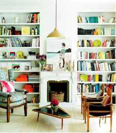 Digging that pair of modern chairs, all the books, and that colorful upholstered chair with the white walls. Modern vibe gone shabby chic with a hint of hipster. Yes please!