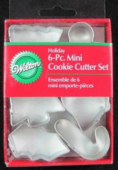 Brand New in box     Has 6 different metal shapes        ANGEL  BELL CANDY CANE  HOLLY LEAF  GINGERBREAD BOY  TREENEW! Wilton **MINI HOLIDAY** 6pc Cookie Cutters NIP