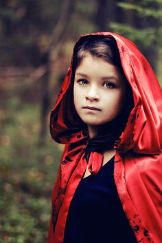 red riding hood. Think I'll buy a wicked hood and have a sweet photo of my daughter taken every few years in this style