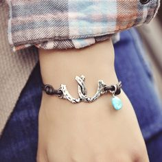 """Double horseshoes with a turquoise accent bead say """"horses give you wings"""" etched on the back. Find more of our horse inspired jewelry at islandcowgirl.com"""