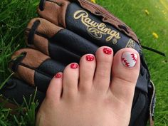 Pretty pedicure: large tone nails are painted to look like a Baseball, small toe nails are red with white polka dots. This is great for Baseball season!!