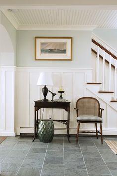 Coastal Home - Seaside Home - Entry - Foyer - Slate Floor - Board and Batten - Shiplap Ceiling - Beadboard Ceiling - Custom Millwork - Caneback Armchair - Side Table - Green Ceramic Stool - Sailboat Art