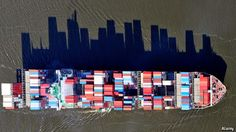 http://www.reddit.com/r/pics/comments/2rhlzz/cargo_ships_supply_a_city_with_goods_the_shadow/