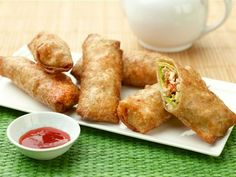 Guy Fieri's Chicken Avocado Egg Rolls are stuffed with chicken and loads of veggies.