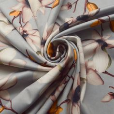 wide polyester elastane fine jersey but this time its grey with the orchid print in the same colours as on the black except the foliage is yellow and rust and brown in the stalks. Shirt Skirt, Top Designer Brands, Fabric Online, Dressmaking, Fabric Design, Orchids, Larger, Branding Design, Fabrics