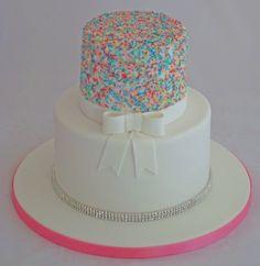 2 tier ladies birthday cake with multi coloured sprinkles and crystal banding. #sprinklescake #sprinkles #prettycake #crystals #bow