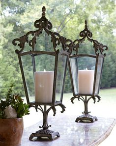 These look like they've been reclaimed from old stone walls. Tuscan ironwork accents mix well with a rustic style. Tuscan Design, Tuscan Style, Rustic Style, Candle Lanterns, Candle Sconces, Flameless Candles, Chandelier Bougie, Style Toscan, French Style