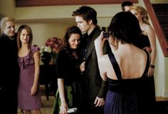 Smile. Alice takes Bella and Edwards picture in the Twilight Saga at her birthday in New Moon
