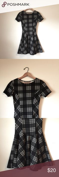 Finn & Clover black and white drop waist dress Beautiful Finn and clover black and white grid print drop waist dress. In excellent condition! This fun dress is perfect for any occasion with black heels and simple jewelry. Finn & clover Dresses Mini