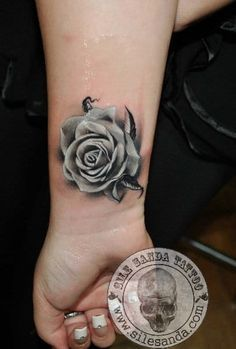 Read this complete guide before getting a rose tattoo. See hand-picked rose tattoo designs for men & women Wrist Tattoo Cover Up, Flower Wrist Tattoos, Wrist Tattoos For Guys, Flower Tattoo Designs, Tattoos For Women Small, Black And White Rose Tattoo, Black Rose Tattoos, Trendy Tattoos, New Tattoos