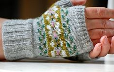 Soft and lightweight, these little colourwork mitts are knit in a pale silver grey lambswool, with accents of green, white and pink. They have a thumb gusset and are interchangeable for left and right hands. Fair Isle Knitting, Hand Knitting, Knitting Patterns, Knitting Machine, Vintage Knitting, Stitch Patterns, Fingerless Gloves Knitted, Knit Mittens, Bracelet Crochet