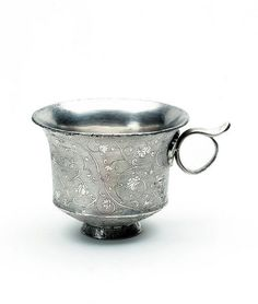 Silver cup with handle, 650-750.China, Tang dynasty (618-960).Chased and punched silver.Height: 5.1 cm, Diameter: 6.5 cm.Museum no. M.32-1935.From the Eumorfopoulos collection, purchased with the assistance of The Art Fund, the Vallentin Bequest, Sir Percival David and the Universities China Committee [Art Fund logo] [2007]© V Images.