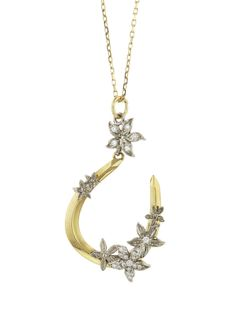 Foundrae Jewelry - Diamond Horseshoe Necklace    Handcrafted in 18-karat yellow gold.  Detailed in diamonds.  Horseshoe measures 1 1/4-in. long.  Necklace measures 22-in. long.  Finished with lobster clasp.