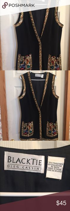 """Oleg Cassini Black Tie Vintage Vest Sequins RARE RARE! I have been unable to find this Vest anywhere on the internet!  Oleg Cassini Black Tie, Vintage Vest! It's black and has very bold Embellished pockets with colored sequins and stones! It is also trimmed in gold beads and sequins! It has one front button that is black with a gold design! There is no size on this piece but I'll list the measurements!  Laying flat: Bust 20"""" Top of Shoulder to bottom 30"""" Oleg Cassini Jackets & Coats Vests"""