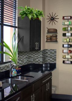 I like the wine rack idea. Great for small kitchens! The tile is beautiful.