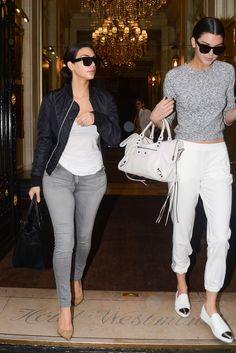 July 10, 2014- Kim Kardashian & Kendall Jenner leaving the Westminister Hotel in Paris.