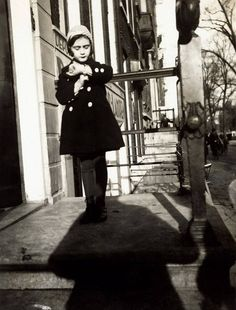 A five-year-old Anne Frank stands on the steps of her father's office. Amsterdam, 1934.   Otto Frank