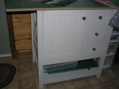 """cutting table made from Martha Steward bathroom vanity table.  Just added 24 x 48 plywood (didn't add the sink).It has 3 drawers, a sliding shelf inside the cupboard, place under for extra cutting matts and it stands 36"""" hight which is just perfect cutting hight for me."""