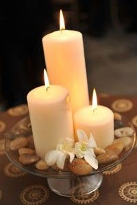 something like this with wood chargers - something around base of candles?  Pine cones, rocks, dried flowers, etc??