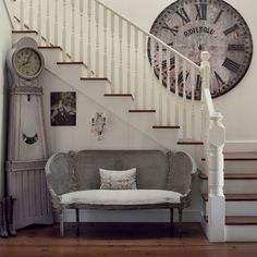 Stairway ~ Huge Rustic Metal Clock, Grandfather Clock, Antique Loveseat, Crystal Wall Sconce