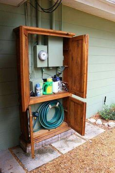 Awesome DIY Outdoor Eyesore Hiding Ideas To Beautify Your Garden Lovely Cabinet Hides Utility Box and Garden Tools Outdoor Projects, Home Projects, Diy Backyard Projects, Garden Projects, Sewing Projects, Armoire Makeover, Garage Makeover, Front Porch Makeover, Home Exterior Makeover
